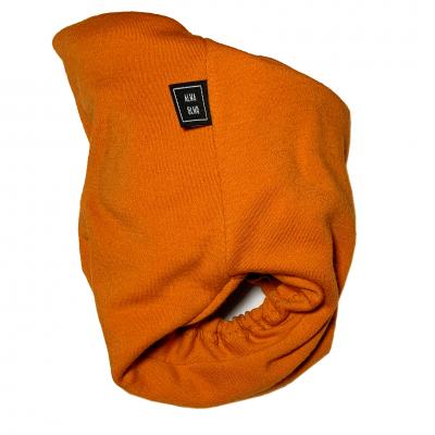 Orange tygblöja sett från sidan